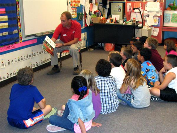 Brian Kabat, owner Frontier Ace Hardware, volunteers a a Guest Reader at DVES